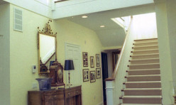 The custom central Staircase and millwork create a sunny inviting space in the entry.