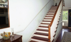 Custom staircase with Tidewater style detail.