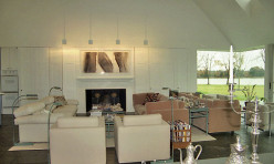 The great room of this contemporary home features 25 foot ceilings.