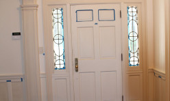 The leaded glass was restored in this c. 1920's entry.