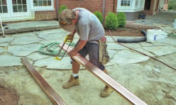 Installing custom copper gutter work for an existing waterfront, traditional home.