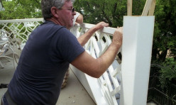 Installation of a custom design Chippendale deck railing.